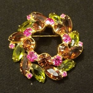 Vintage gold tone brooch with stones